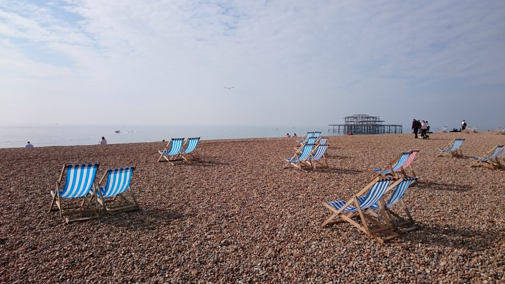 Beach chairs on Brighton beach, just 40 minutes away from The Green